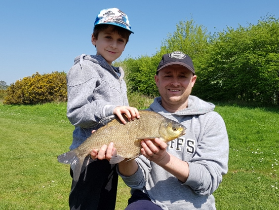 father and son fishing lesson