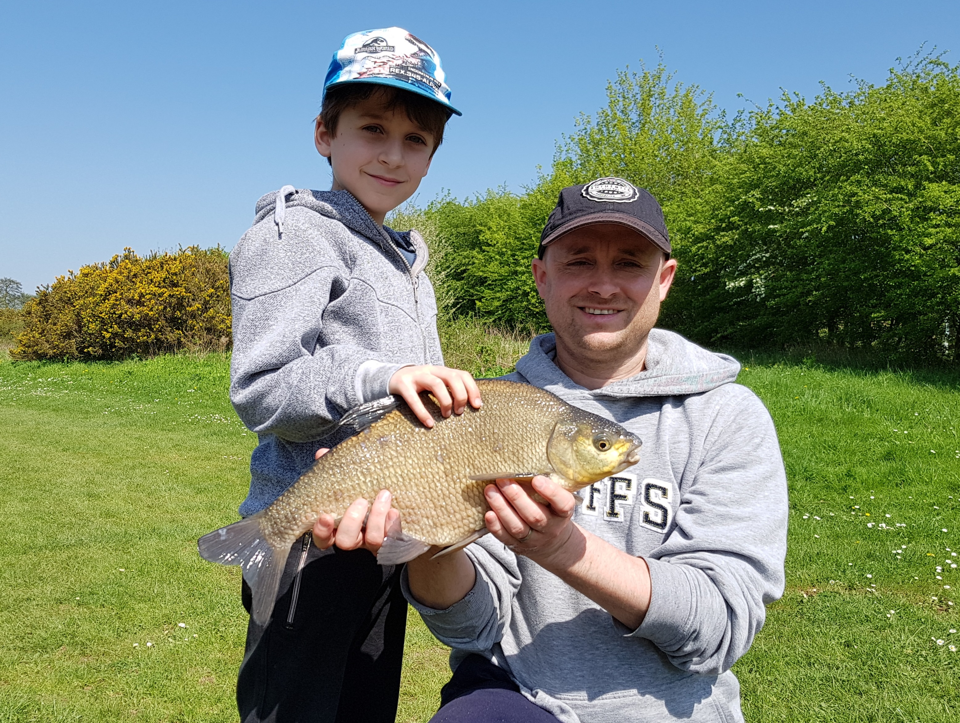 dad and son fishing lesson