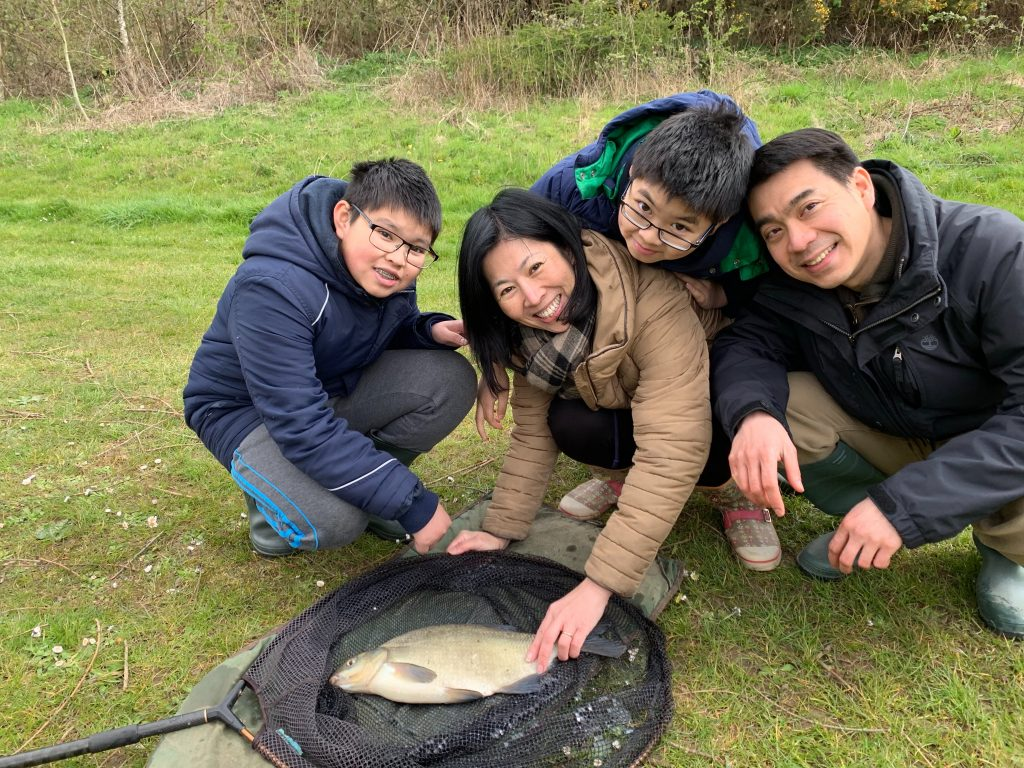 TJ's family with a bream
